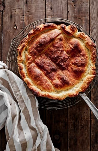 Apple Tart Baked in Fry Pan on Wood surface
